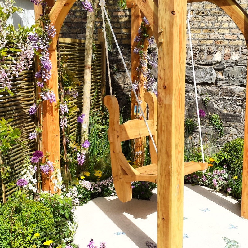 Custom made timber swing with willow fence